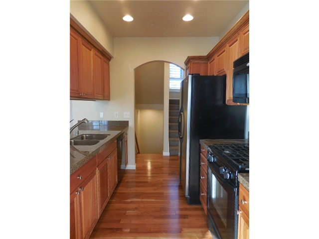 The spacious kitchen features granite tile counter tops and is o